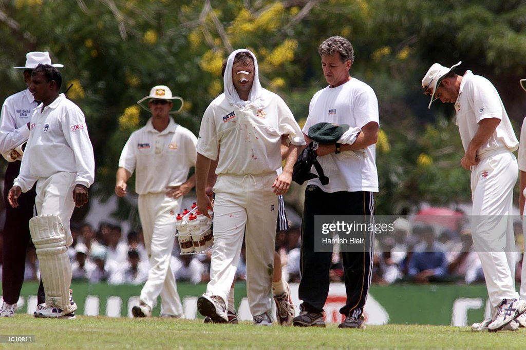 Steve Waugh leaves the field with assistance from Physio Errol Allcot after Jason Gillespie and Steve Waugh of Australia collided attempting a catch, during day two of the First Test between Sri Lanka and Australia at Asgiriya Stadium, Kandy, Sri Lanka. Mandatory Credit: Hamish Blair/ALLSPORT