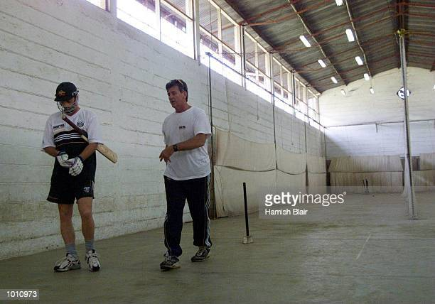 Steve Waugh of Australia talks with Physio Errol Allcot after his first bat since breaking his nose last week during training in the indoor nets at...