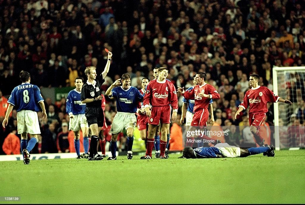 Steven Gerrard of Liverpool is shown the red card after his foul on Everton's Kevin Campbell during the FA Premier League match between Liverpool and...