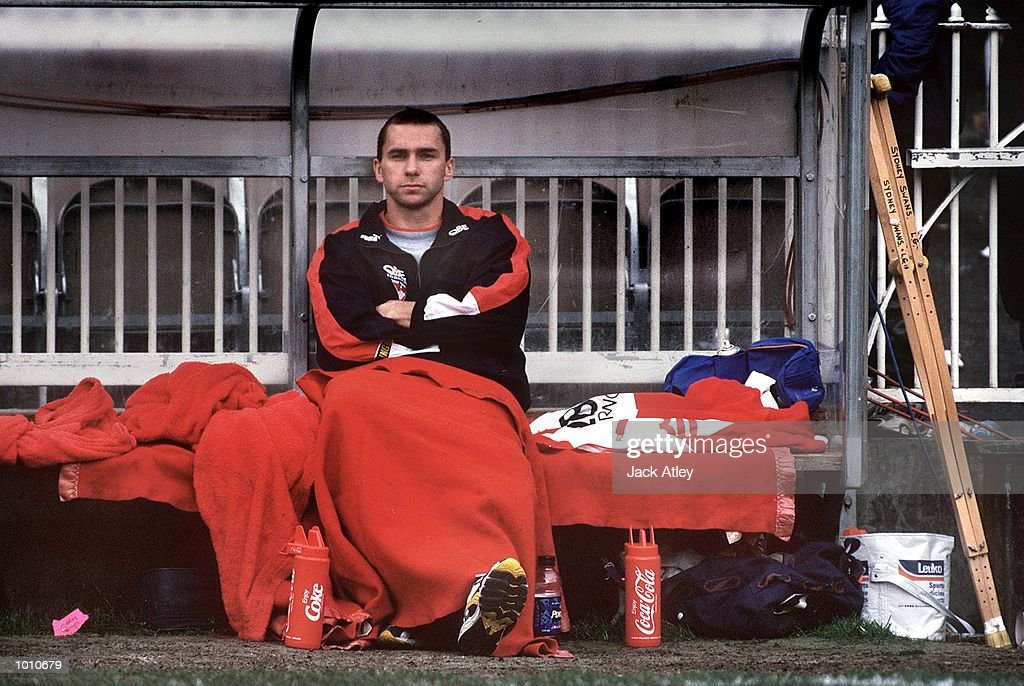 Sydney Swans captain Paul Kelly #14 sits on the interchange bench after badly injuring his knee during the fourth qualifying final played at the Melbourne Cricket Ground, Melbourne, Australia between Essendon and Sydney. Essendon won the match easily, finishing Sydney's season. Mandatory Credit: Jack Atley/ALLSPORT