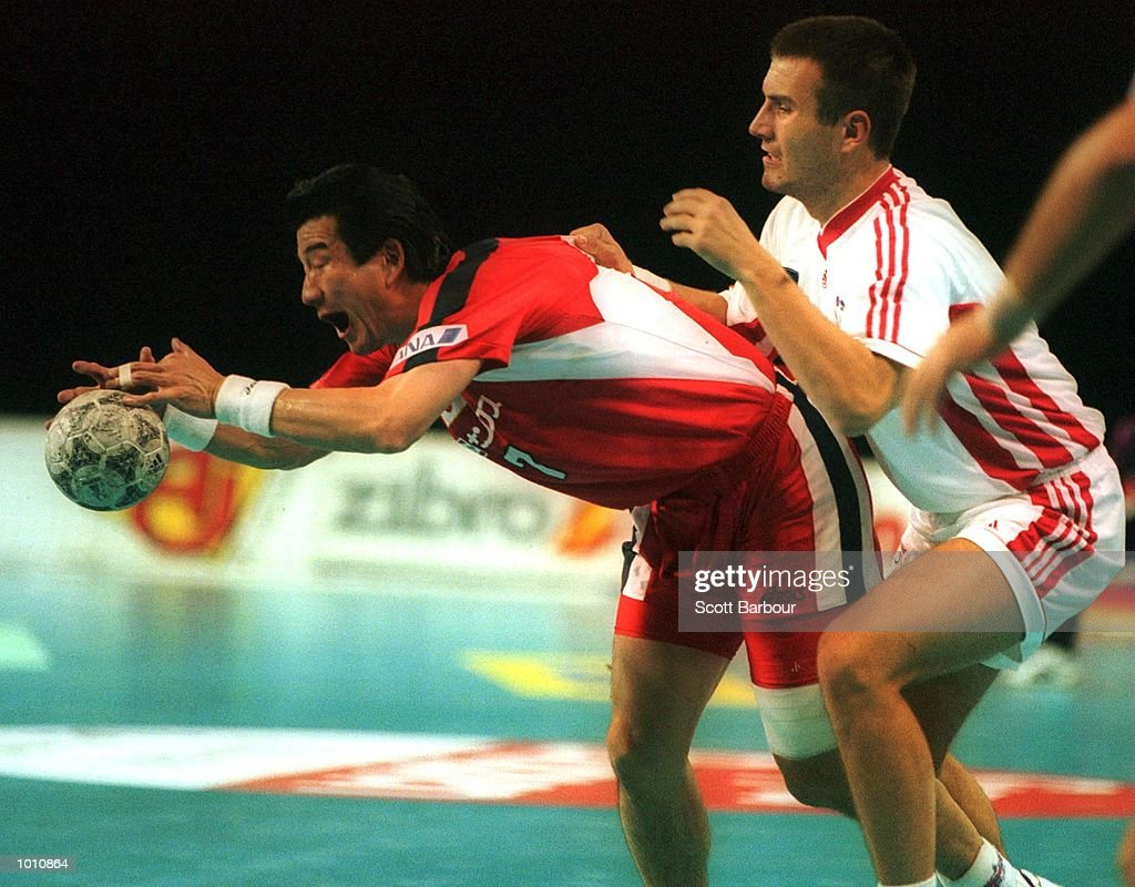 T. Nakayama of Japan is defended closely by B. Fanic of Croatia during the match between Japan and Croatia at the Southern Cross International Handball Challenge, a SOCOG Olympic test event, Buring Pavilion, Olympic Park Homebush, Sydney, Australia. Mandatory Credit: Scott Barbour/ALLSPORT
