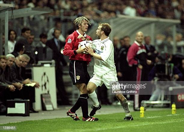 Tempers flare between David Beckham of Manchester United and Roman Mahlich of Graz during the UEFA Champions League match between Sturm Graz and...
