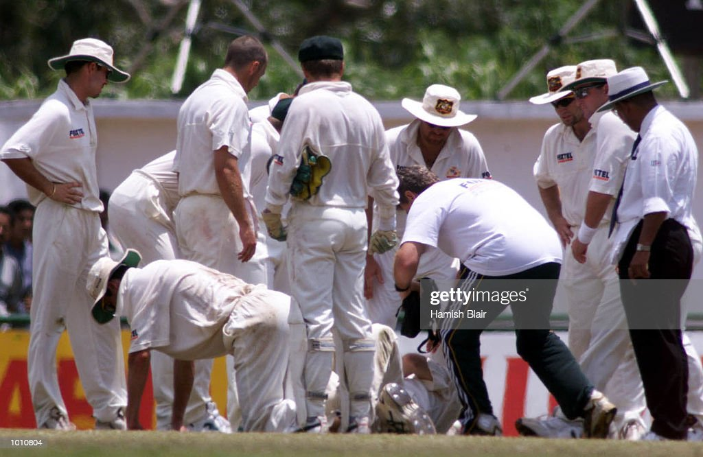 The Australian tean crowd around after Jason Gillespie and Steve Waugh of Australia collided attempting a catch, during day two of the First Test between Sri Lanka and Australia at Asgiriya Stadium, Kandy, Sri Lanka. Mandatory Credit: Hamish Blair/ALLSPORT