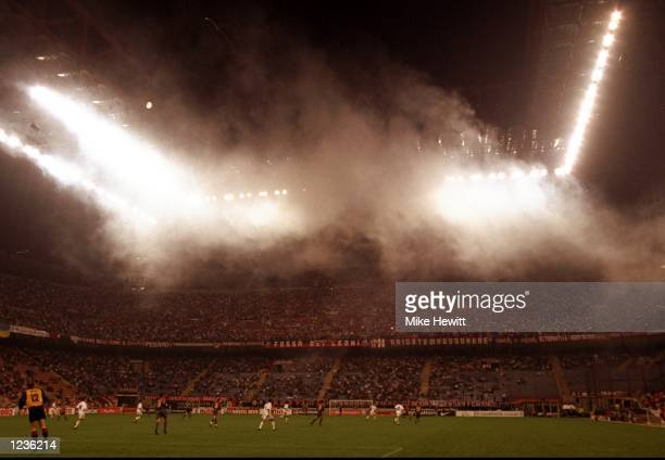 The smoke filled San Siro during the Champions League match between AC Milan and Galatasaray in Milan Italy Mandatory Credit Mike Hewitt /Allsport