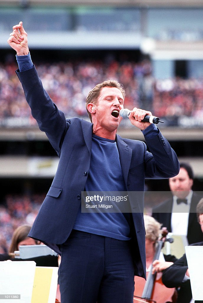 Todd McKenney sings to the crowd, during the Pre-match entertainment, in the AFL Grand Final match between the Kangaroos and Carlton, played at the Melbourne Cricket Ground, Melbourne, Australia. Mandatory Credit: Stuart Milligan/ALLSPORT
