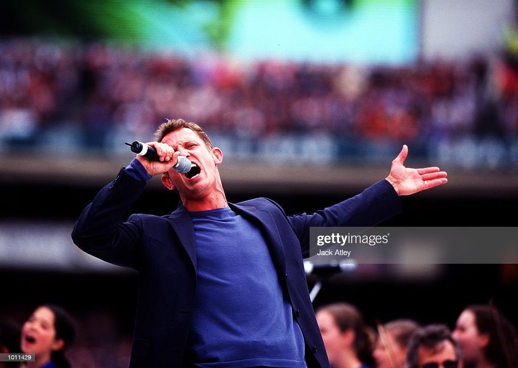 Todd McKinney sings to the crowd during the Pre-match entertainment, in the AFL Grand Final match between the Kangaroos and Carlton, played at the Melbourne Cricket Ground, Melbourne, Australia. The Kangaroos defeated Carlton. Mandatory Credit: Jack Atley/ALLSPORT