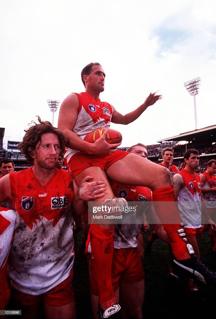 Tony Lockett #4 for the Sydney Swans is carried by teammates from the arena following the fourth qualifying final played at the Melbourne Cricket Ground, Melbourne, Australia between Essendon and Sydney. Lockett, who is the A.F.L. all time leading goalkicker retired after the match. Essendon won the match easily. Mandatory Credit: Mark Dadswell/ALLSPORT