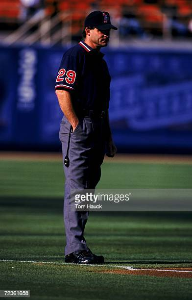 Umpire Bill Hohn stands on the field during a game between the Los Angeles Dodgers and the Milwaukee Brewers at Dodger Stadium in Los Angeles...