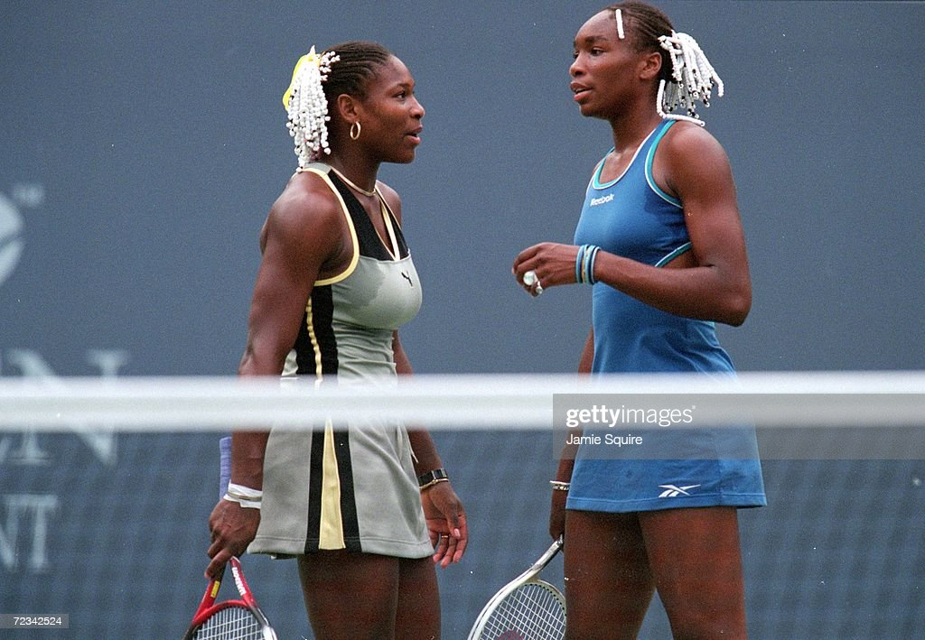 Venus Williams of the USA talks to her sister Serena Williams at the US Open at the USTA National Tennis Courts in Flushing Meadows, New York. Mandatory Credit: Jamie Squire /Allsport