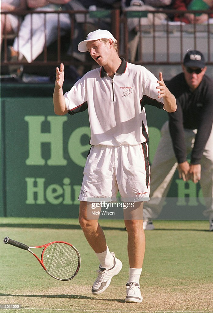 Yevgeny Kafelnikov of Russia throws his racquet in frustration during his 2-6, 7-6, 2-6, 0-6 defeat by Wayne Arthurs of Australia during the Davis Cup semi final at the ANZ Stadium, Brisbane, Australia. Mandatory Credit: Nick Wilson/ALLSPORT
