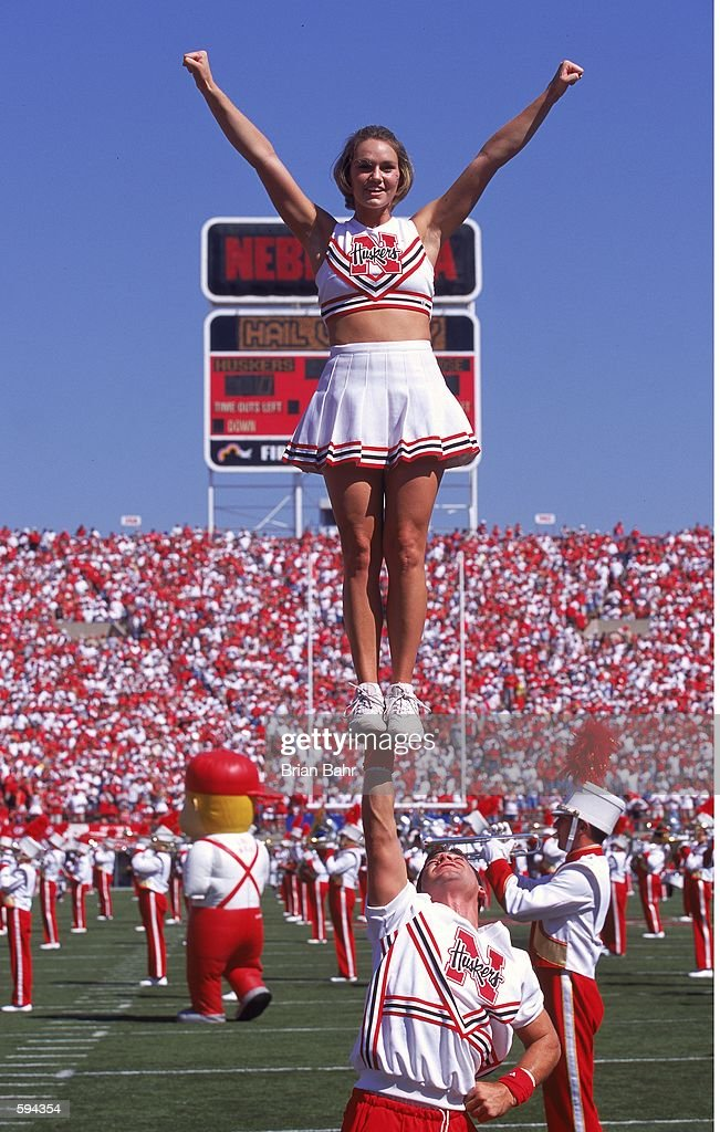 A general view of a cheerleader for the Nebraska Cornhuskers being raised up at the halftime show during the game against the San Jose State Spartans...