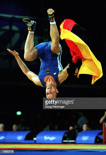 Alexander Leipold of Germany celebrates winning the Freestyle wrestling gold medal in the 76 kilogram category held at the Sydney Convention and...