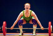 Amanda Phillips of Australia in action in the Women's 63kg Weightlifting event at the Convention Centre in Darling Harbour on Day Four of the Sydney...