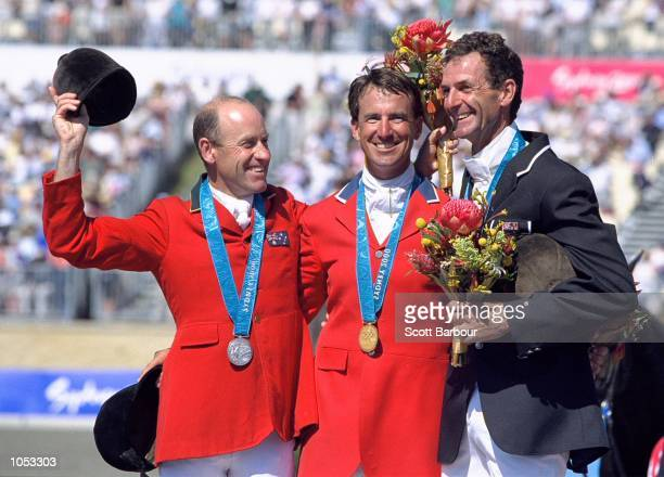 Andrew Hoy of Australia David O''Connor of the USA and Mark Todd of New Zealand celebrate on the podium after the Individual Three Day Event Show...