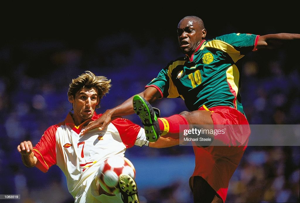 Angulo of Spain is challenged by Patrick Mboma of Cameroon during the Mens Football Final at the Olympic Stadium on Day 15 of the Sydney 2000 Olympic Games in Sydney, Australia. Cameroon won on penalties. \ Mandatory Credit: Michael Steele /Allsport