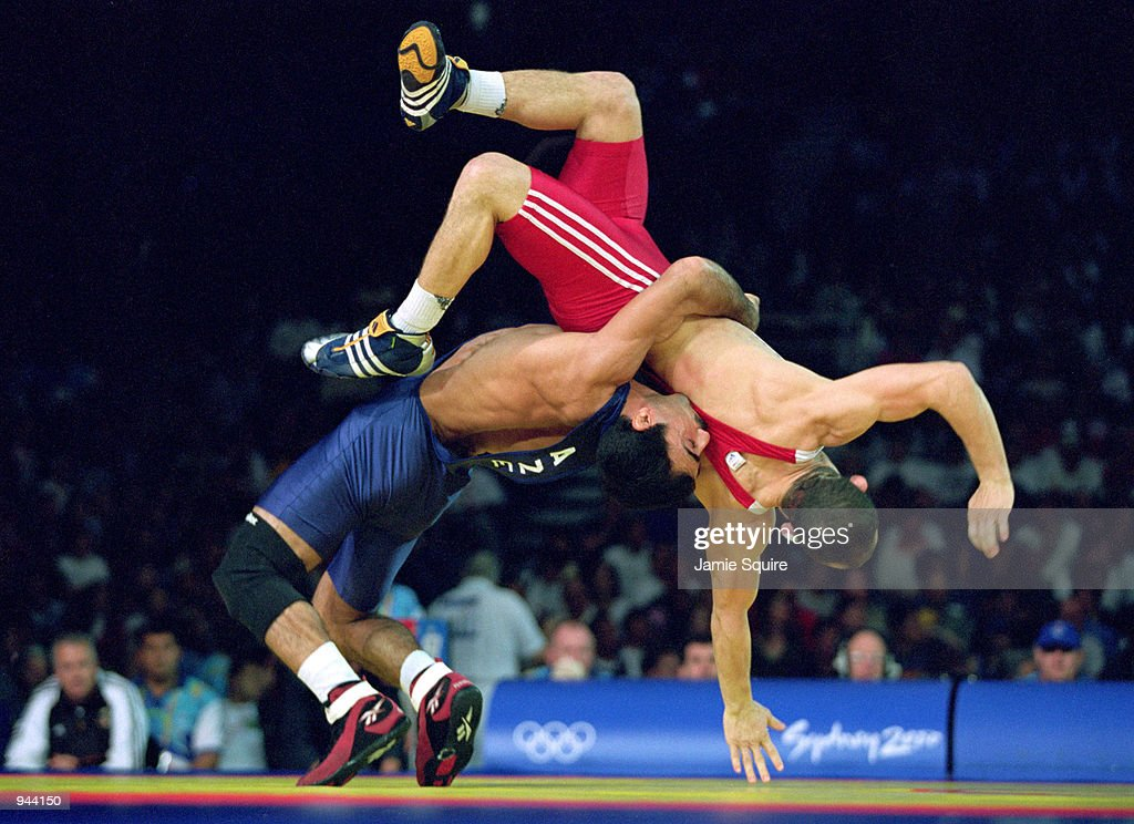 Arif Abdullayev of Azerbaijan (blue) and Othmar Kuhner of Germany in the Mens 58 kg Greco Roman Wrestling at the Exhibition Halls on Day 14 of the Sydney 2000 Olympic Games in Sydney, Australia. \ Mandatory Credit: Jamie Squire /Allsport