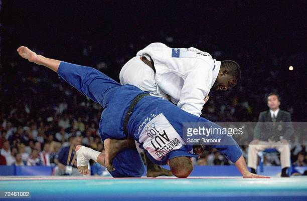 Ato Hano of the USA flips his opponent Franz Birkfellner of Austria during the Men's 100 kg judo match at the Sydney Olympic Games in Sydney...
