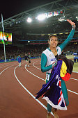 Cathy Freeman of Australia celebrates winning Gold in the Womens 400m Final at the Olympic Stadium on Day Ten of the Sydney 2000 Olympic Games in...
