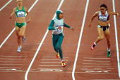 Cathy Freeman of Australia crosses the line to win gold in the Womens 400m Final at the Olympic Stadium on Day Ten of the Sydney 2000 Olympic Games...