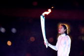 Cathy Freeman of Australia holds the Olympic Torch prior to lighting the Olympic Flame during the Opening Ceremony of the Sydney 2000 Olympic Games...