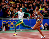 Cathy Freeman of Australia in action during the Women's 400m final held at Olympic Stadium during the Sydney 2000 Olympic Games Sydney Australia...