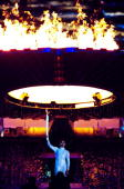 Cathy Freeman of Australia lights the Olympic Flame during the Opening Ceremony of the Sydney 2000 Olympic Games at the Olympic Stadium in Homebush...