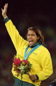 Cathy Freeman of Australia on the podium celebrating gold in the Womens 400m Final at the Olympic Stadium on Day 10 of the Sydney 2000 Olympic Games...