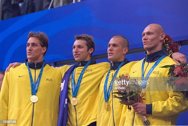 Chris Fydler Ian Thorpe Ashley Callus and Michael Klim of Australia celebrate after winning Gold in the Mens 4 x 100m Freestyle Relay at the Sydney...
