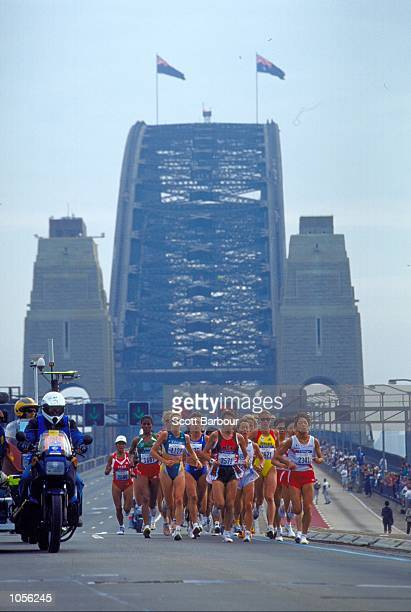 Competitors cross the Sydney Harbour Bridge during the Womens Marathon on Day Nine of the Sydney 2000 Olympic Games in Sydney Australia Mandatory...