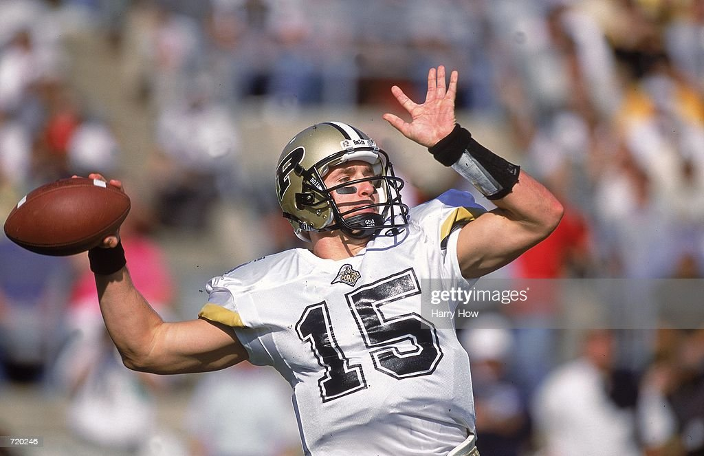 Drew Brees of the Purdue Boilermakers drops back to pass the ball during the game against the Penn State Nittany Lions at the Beaver Stadium in...