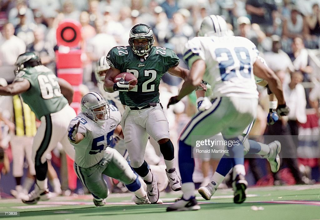 Duce Staley of the Philadelphia Eagles carries the ball up the field during a game against the Dallas Cowboys at Texas Stadium in Irving Texas The...