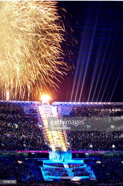 Fireworks explode over the Olympic Flame during the Opening Ceremony of the Sydney 2000 Olympic Games at the Olympic Stadium in Homebush Bay Sydney...