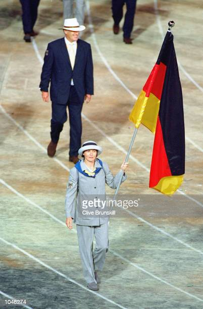 Flag bearer and canoe competitor Birgit Fischer leads round the German Olympic Team during the Opening Ceremony of the Sydney 2000 Olympic Games at...