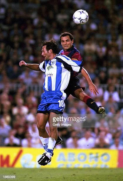 Francisco Rufete of Malaga and Barjuan Sergi of Barcelona in action during the Spanish Primera Liga match between Barcelona and Malaga at the Nou...