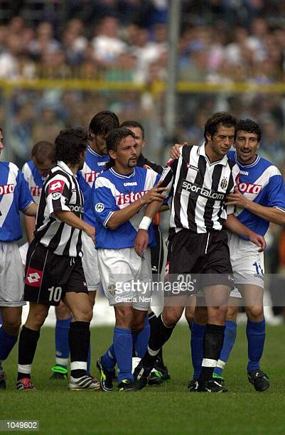 From left to right Alessandro Del Piero Roberto Baggio Alessio Tacchinardi and Dario Hubner during a heated moment in the Coppa Italia first leg...