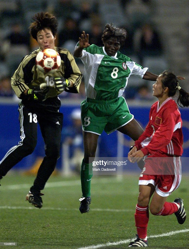 Goalkeeper Hong Gao of China leaps to catch the ball from Rita Nwadike of Nigeria during the Women's Group F Football Match during the Sydney 2000...