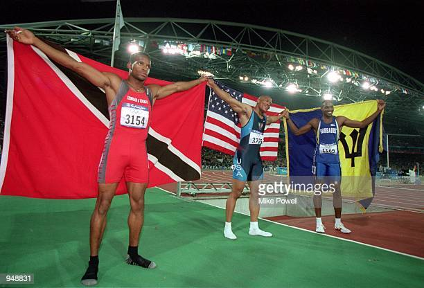 Gold medallist Maurice Greene of the USA with silver winner Ato Boldon of Trinidad and Tobago and bronze winner Obadele Thompson of Barbados after...