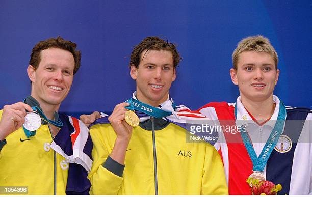 Grant Hackett of Australia wins gold in the Men's 1500m Freestyle beating compatriot Kieren Perkins and bronze medallist Chris Thompson of the USA at...