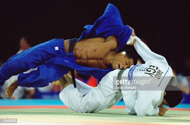 Hatham Aiwad of Egypt takes on Hector Lombart of Cuba in the Men's Judo 73kg bout at the Exhibition Halls in Darling Harbour on Day Three of the...