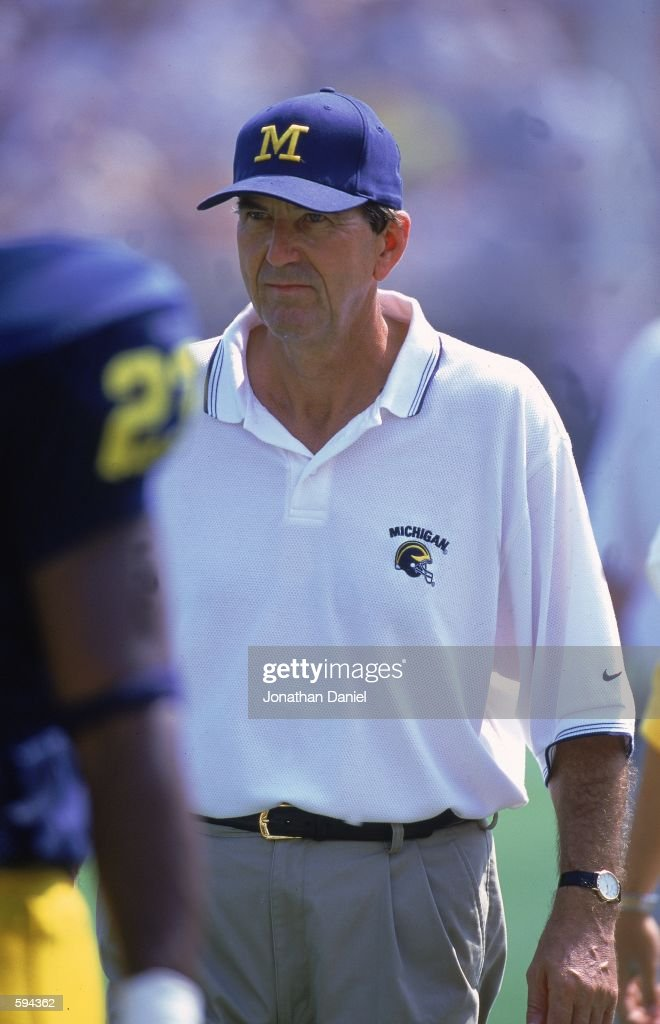 Head Coach Lloyd Carr of the Michigan Wolverines walks on the field during the game against the Bowling Green Falcons at the Michigan Stadium in Ann...