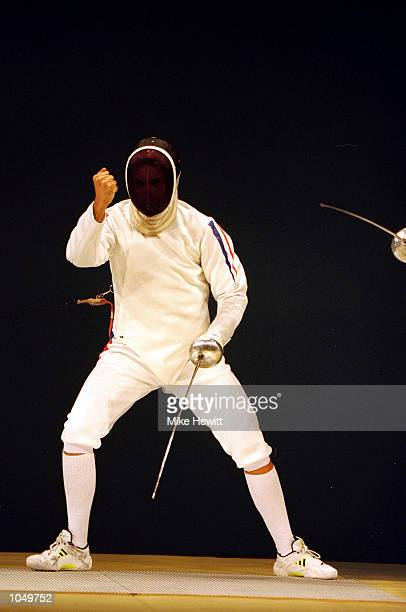 Hugues Obry of France celebrates his Silver Medal win in the Mens Fencing Individual Epee at the Exhibition Halls in Darling Harbour on Day One of...