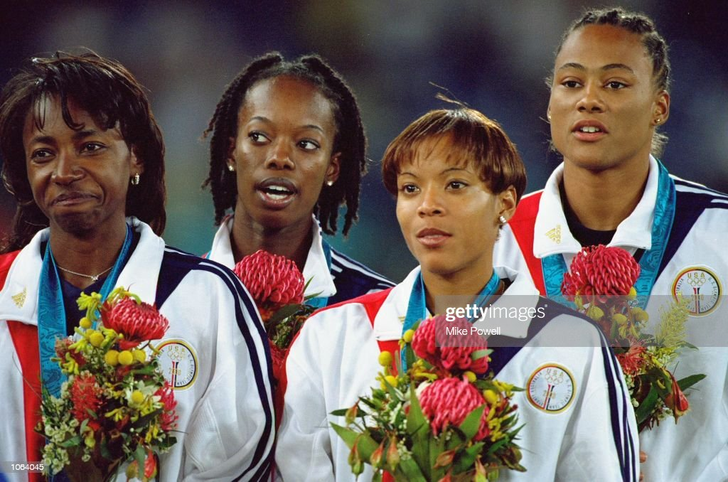 Jearl Miles-Clark, Monique Hennagan, Marion Jones and La Tasha Colander-Richardson of the USA on the podium after winning gold in the Womens 4x400m Relay Final at the Olympic Stadium on day 15 of the Sydney 2000 Olympic Games in Sydney, Australia. \ Mandatory Credit: Mike Powell /Allsport