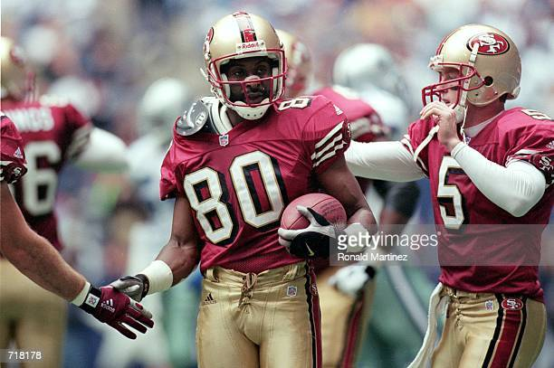 Jerry Rice of the San Francisco 49ers get congradulated on his touchdown by teammate Jeff Garcia during the game against the Dallas Cowboys at the...