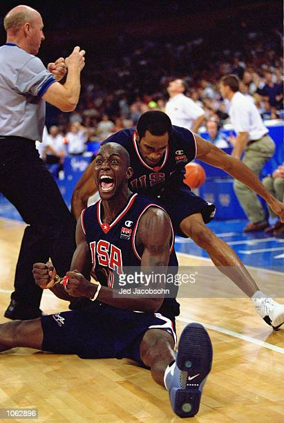 Kevin Garnett and Vince Carter of the USA celebrate victory in the Mens Basketball Semifinal against Lithuania at the Sydney SuperDome on day 14 of...