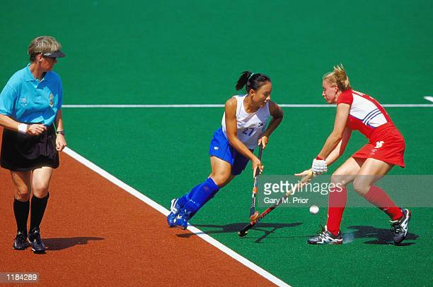 KoWoon Oh of Korea takes on Kate Walsh of Great Britain during the Womens Hockey match at the State Hockey Centre on Day Five of the Sydney 2000...