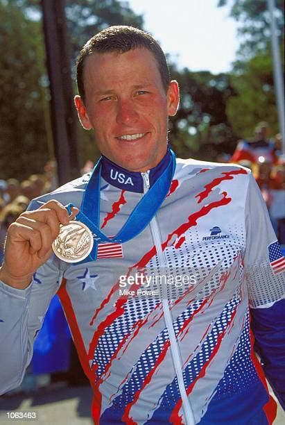 Lance Armstrong of the USA celebrates bronze in the Mens Road Cycling Individual Time Trial at Moore Park on day 15 of the Sydney 2000 Olympic Games...