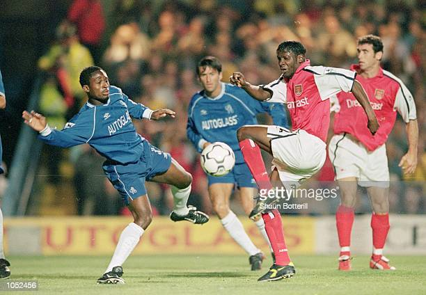 Lauren of Arsenal fights for the loose ball with Celestine Babayaro of Chelsea during the FA Carling Premiership match at Stamford Bridge in London...