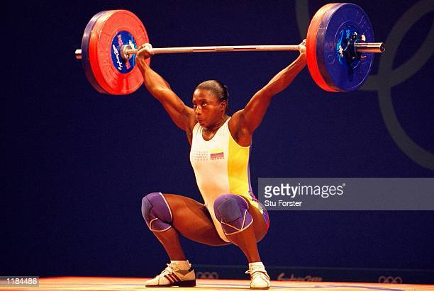 MariaIsabel Urrutia of Colombia on her way to Gold in the Womens 75kg Weightlifting at the Sydney Convention Centre on Day Five of the Sydney 2000...