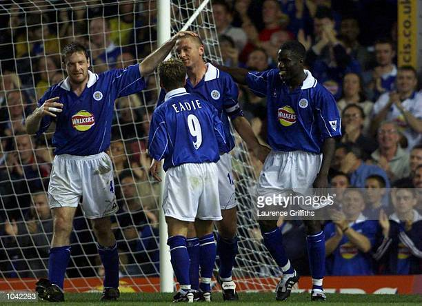 Matt Elliott of Leicester is congratulated and Ade Akinbiyi after scoring the 2nd goal during the Carling Premiership fixture between Leicester City...