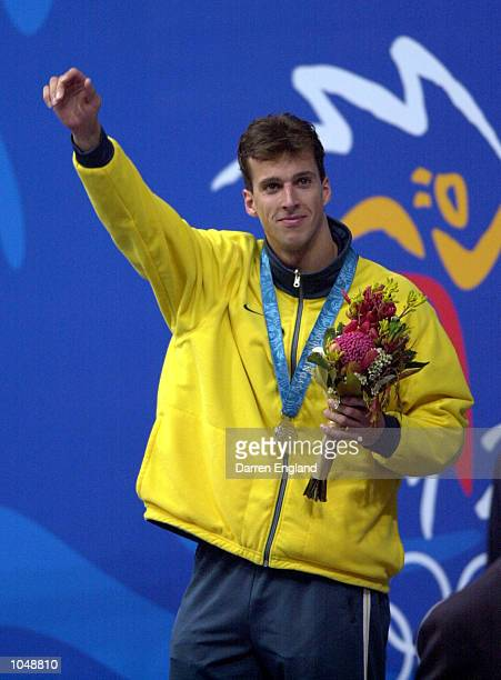 Matthew Welsh of Australia celebrates his Silver Medal after the Men's 100m Backstroke Final at the Sydney 2000 Olympic Games Sydney Australia...